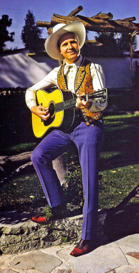 A very untypical outfit for Gene Autry as he strums his Martin guitar.