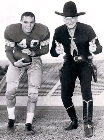 "Two for the price of one! Halfback Howard Cassady of the Ohio State Buckeyes ('52-'55) poses with William ""Hopalong Cassidy"" Boyd. Cassady won the Heisman trophy in '55 and was elected to the college football hall of fame in '79. (Thanx to Jerry Whittington.)"