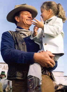 "John Wayne with daughter Aissa in 1960 while making ""The Alamo""."
