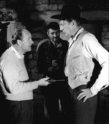 "Director Anthony Mann discusses the next scene for ""Man of the West"" ('58) with Gary Cooper. (Thanx to Jerry Whittington.)"