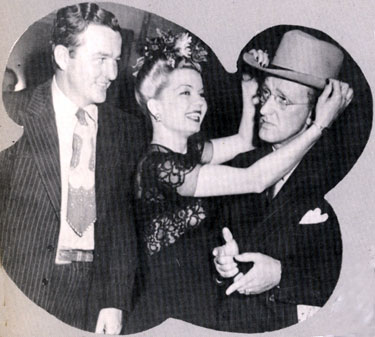 Jimmy Wakely and singer Frances Langford clown around with bandleader Kay Kyser circa 1945.