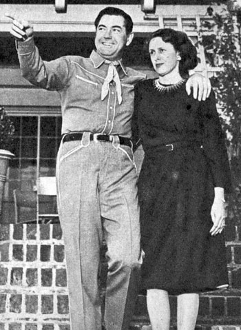 Johnny Mack Brown and his wife, the former Cornelia Foster, in 1946 in front of their 16 room English colonial house in Beverly Hills.