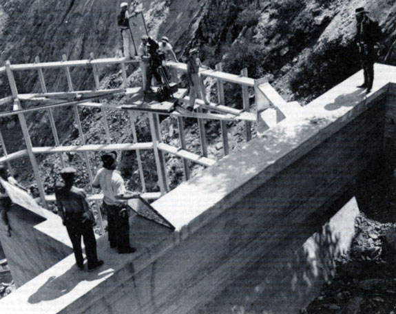 "The crew sets up a shot at Pacoima Dam for the Republic serial ""Zorro Rides Again"" ('37). John Carroll...or probably his stuntman, stands ready for the shot to the right."