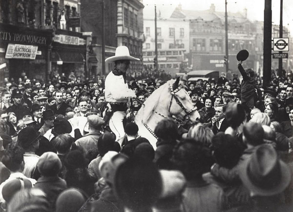 Tom Mix thronged by a crowd during his final British tour in 1938. Tom is not riding Tony, but instead his daughter Ruth's horse Warrior which she used in her circus work. Tom elected to use Warrior instead of Tony as Warrior was bigger and could be seen better. (Thanx in part to Bud Norris.)
