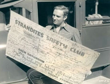 "Gene reads some really large fan mail in 1935 for ""Phantom Empire"" showing at Brir's Strand (wherever that was). (Thanx to Jerry Whittington.)"