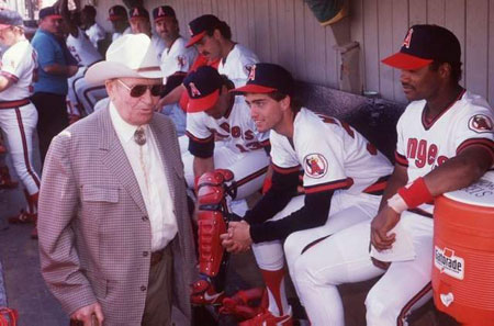 Angels team owner Gene Autry walks through the Angels' dugout during a 1989 Spring training game in Palm Springs.
