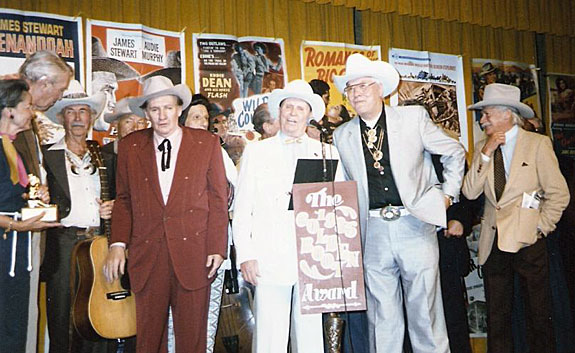 1985 Golden Boot Awards. (L-R) Pam Murphy (Audie's widow), James Stewart, Eddie Dean, Jerry Scoggins, Pat Buttram, Iron Eyes Cody, Gene Autry, Monte Hale, Richard Farnsworth talks to Dale Robertson behind Monte.