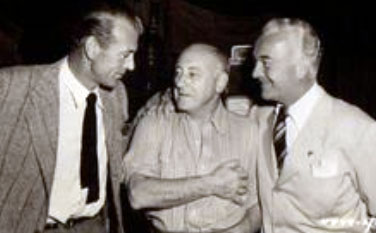 Gary Cooper and William Boyd chat with director Cecil B. De Mille in 1940. (Thanx to Jerry Whittington.)