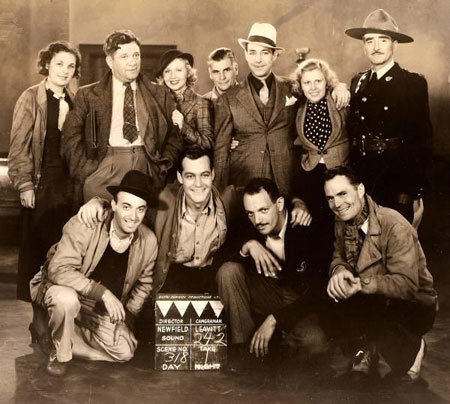 "Cast and crew of the Canadian made ""Undercover Men"" ('35). (L-R standing). Unidentified woman, director Sam Newfield, heroine Adrienne Dore, unidenitfied man, Kenne Duncan, unidentified woman, Wheeler Oakman. (Kneeling L-R). Unidentified man, Charles Starrett, possibly Eric Clavering, Phil Brandon. (Thanx to Jerry Whittington.)"