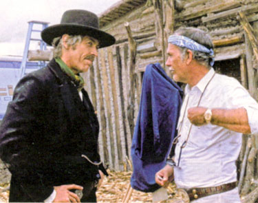 "James Coburn and director Sam Peckinpah discuss a scene while making ""Pat Garrett and Billy the Kid"" ('73)."
