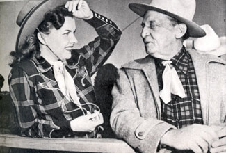 Gale Storm chats with Raymond Hatton at the Palm Springs rodeo circa 1952.
