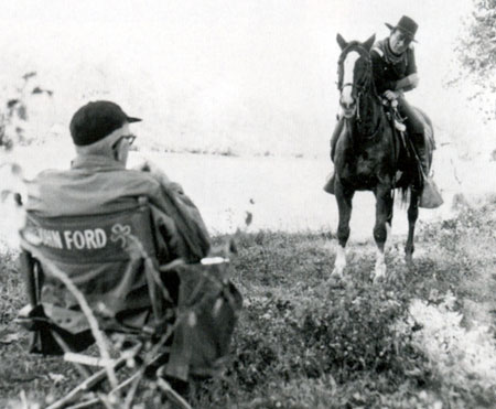 "John Ford gives John Wayne a bit of direction on ""The Horse Soldiers"" ('59)."