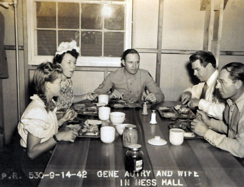 Gene's wife Ina has dinner with Gene and others in the mess hall. September 14, 1942. (Thanx to Dave Straub.)