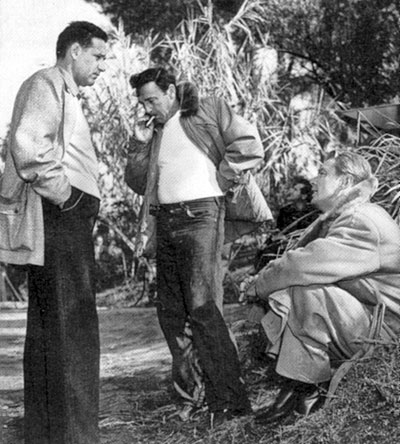 "Director Gordon Douglas (center) confers with producer Marty Rackin and Alan Ladd during the shooting of ""Santiago"" ('56) set in Cuba during the 1898 conflict between the U.S. and Spain."