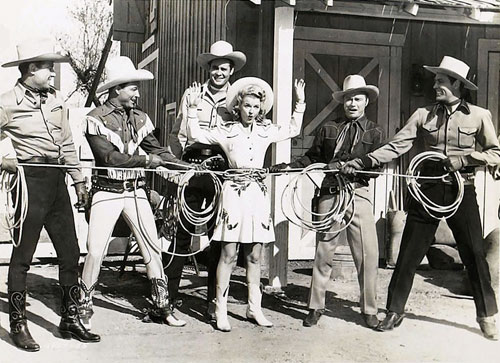 "Having a little fun during the filming of Republic's ""Bells of Rosarita"" ('45) are (L-R) Bob Livingston, Roy Rogers, Sunset Carson, Dale Evans, Don Barry and Allan Lane. (Thanx to Jerry Whittington.)"