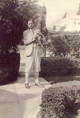 For a rough B-Western heavy, in his off-screen hours Ed Cobb was certainly duded up in his Plus Fours (breeches or trousers) and pipe. Looks like he was walking the cat. Photo from sometime in the '30s. (Thanx to John Bickler.)