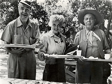 "Ken Murray, Laurie Anders and Hoot Gibson take a lunch break while making ""The Marshal's Daughter"" ('53)."