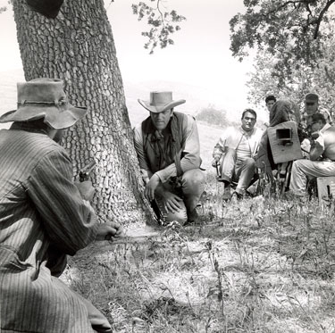 "Director Andrew McLaglen guides James Arness through a scene for ""Gunsmoke"". (Thanx to Neil Summers.)"