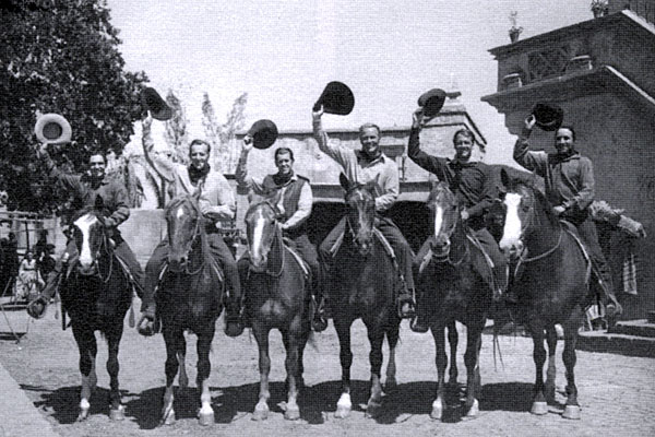 "The casts of two Warner Bros. westerns were shooting on adjacent locations when they came together for this photo in 1949. (L-R) Bob Steele, Bruce Bennett, James Brown, Wayne Morris, Joel McCrea, Victor Jory. Steele, McCrea and Jory were working on ""South of St. Louis"" while Bennett, Brown and Morris were working on ""The Younger Brothers""."