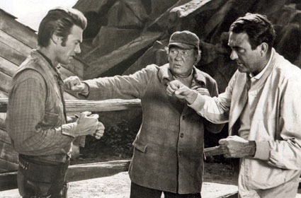 "Victor McLaglen and son Andrew McLaglen (directing) give Clint Eastwood a few pointers on the proper way to throw a punch on the set of ""Rawhide"" in '59."