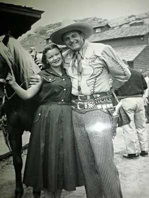 "At Corriganville, Ray ""Crash"" Corrigan gets a hug from an adoring fan."