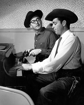 "Dale Robertson clowns on the piano with Steve Allen on a ""Steve Allen Show"" in 1958."