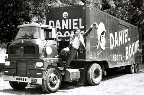 "Ready for the fourth season of ""Daniel Boone"", Fess Parker waves a go-ahead from the cab of the 40 ft. 20th Century-Fox property truck. (Thanx to Neil Summers.)"