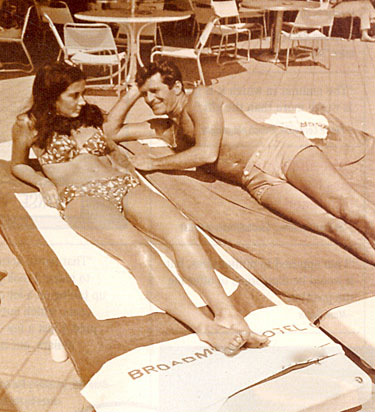 Hugh O'Brian and friend relax poolside at the Broadmoor Hotel in Colorado Springs, CO, in the early '60s.