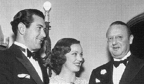 Johnny Mack Brown, Fay Wray and Jesse Lasky at a Gary Cooper home party.