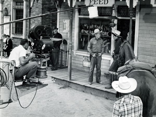 "Shooting a scene for Disney's ""Texas John Slaughter"" with Harry Carey Jr. and Tom Tryon. Character actor Hugh Sanders stands on the left. (Thanx to Neil Summers.)"