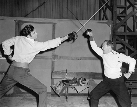 "Rod Cameron gets a fencing lesson in preparation for ""Pirates of Monterey"" ('47 Universal). (Thanx to Bobby Copeland.)"