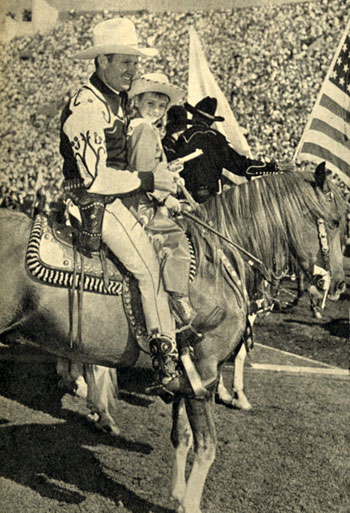 It was a day of thrills and spills for some 100,000 fans at the 5th Annual Sheriff's Rodeo at the L.A. Coliseum in late 1949. The photo above of Gene Autry with fan Eleanor Truitt and the following six photos are all from that rodeo.