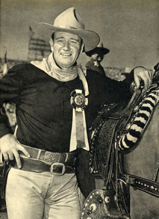 "Rodeo Grand Marshal John Wayne. Note the ""Red River"" belt buckle."