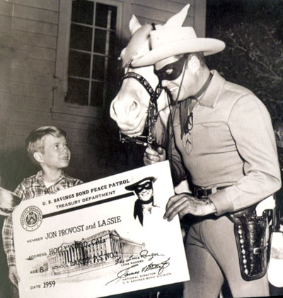 "Jon Provost of ""Lassie"" and Clayton Moore as the Lone Ranger promote the U.S. Savings Bond Peace Patrol for the Treasury Dept. in 1959."