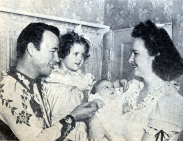 Roy Rogers with three year old daughter Cheryl, months old Linda Lou and wife Arlene in mid 1943.