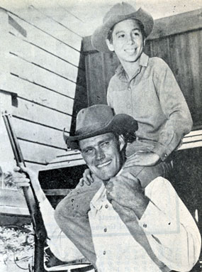 "Chuck Connors and Johnny Crawford on the set of ""The Rifleman""."