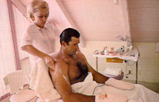 For three weeks four times a year men were allowed in the mid-'60s to take over from the ladies at the health-beauty-reducing resort The Golden Door just north of San Diego. Celebrities paid $500 and more a week to exercise to the utmost on 1200-calories-a-day. Above Clint Walker and Sam Jaffe in an isometric exercise. Below a beauty operator works on Clint Walker who refused a foot massage but submitted to manicure, hand massage and pink warming mittens.