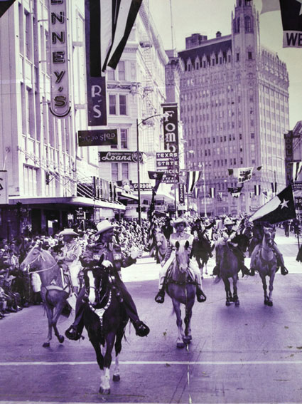 Gene Autry leads a parade in downtown San Antonio, TX. Gene was there for the Livestock Show and Rodeo in 1958.