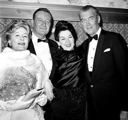 "Irene Dunne, John Wayne, Rosalind Russell and James Stewart at the premiere of ""How the West Was Won"" in 1962."