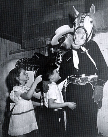 Quiz Kids Ruth Duskin and Joel Kupperman visit the Lone Ranger, Brace Beemer, and his horse Silver at the NBC studios in the early '40s.