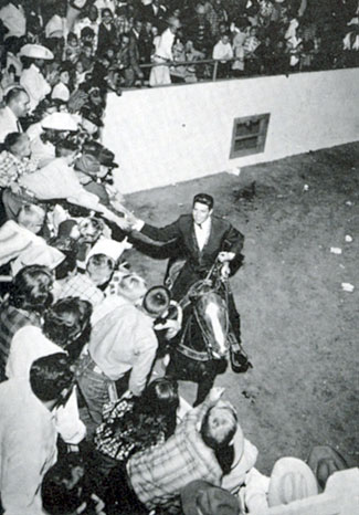 Dale Robertson shakes hands with fans at Tingley Coliseum at the New Mexico State Fair in Albuquerque in 1959.