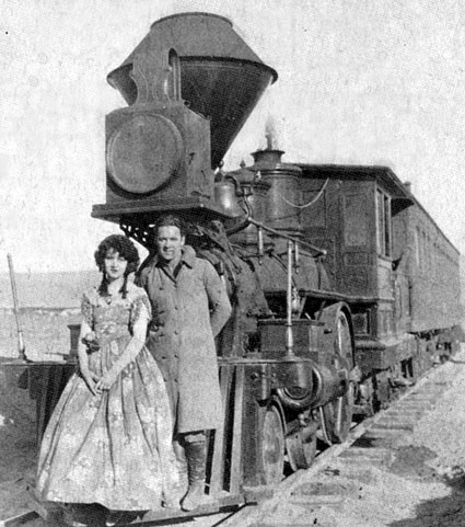 "Madge Bellamy and George O'Brien on location for ""The Iron Horse"" in 1924, directed by John Ford."