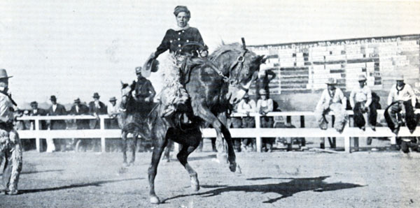 An early day photo of Hoot Gibson making a rodeo ride on Sky Rocket.