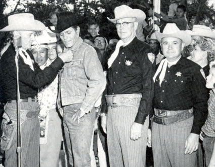 "TV's ""Stoney Burke"", Jack Lord, receives an honorary membership into the Albuquerque Sheriff's Posse during his appearance at the 1964 New Mexico State Fair."