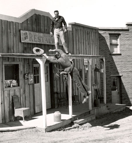 "A great action shot from TV's ""Cowboy G-Men"" starring Russell Hayden. The badman is caught by the camera in freefall from the rooftop."