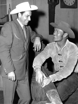 """The Rifleman"", Chuck Connors talks with ??? Does anyone know who the gentleman might be? (Thanx to Doug Abbott.)"