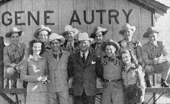 Photo in Gene Autry, OK, in 1945. Berwyn, OK, became Gene Autry, OK, on November 5, 1941. (L-R) Minnie Pearl, Gene's brother Doug, Golden West Cowboy's manager Adams, Pee Wee King, Becky Barfield. Pee Wee's Golden West Cowboys in the back.