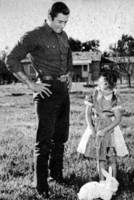 Clint Walker and daughter Valerie Jean and her pet rabbit. Circa March '58.