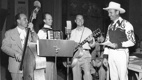"Gene Autry and the Cass County Boys at a ""Gene Autry Melody Ranch Radio Show"" rehearsal. Circa 1950. (© Autry Qualified Interest Trust and Autry Foundation.)"