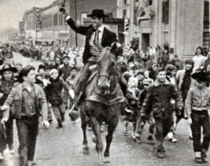"Hugh O'Brian as ""Wyatt Earp"" followed by eager fans during a Dodge City visit in 1958."